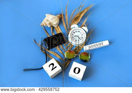 Calendar For August 20 : The Name Of The Month Of August In English, Cubes With The Number 20, A Dry