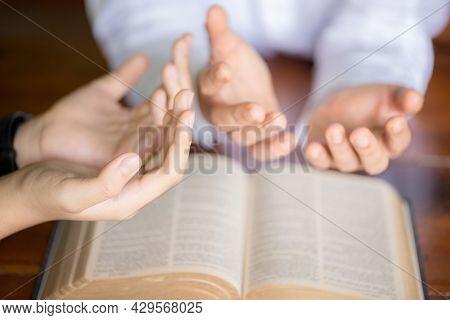 Woman Hand With Bible Praying.