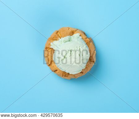 Top View Fresh Hami Melon Flavor Ice Cream On Top Of Crackers On Blue Background
