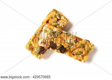 Top View Sweet Caramel Treats With Raisins And Melon Seeds On White Background