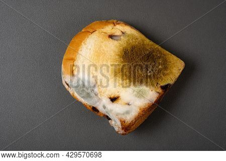 Top View Moldy Bread On A Dark Background