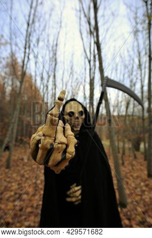 Death In The Autumn Forest.skull Halloween Costume. Halloween And Horror Concept.autumn Traditional