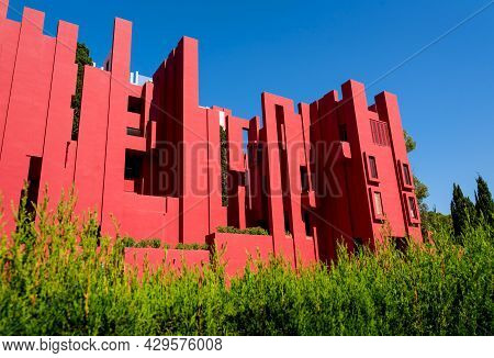 Calpe, Spain - 19 July 2021: The Postmodern Apartment Building 'la Muralla Roja', The Red Wall, By A
