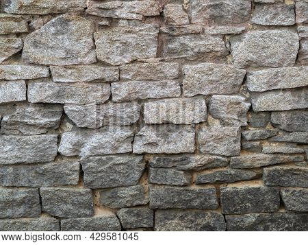 Backgrounds Of The Old Fortress Wall. Ancient Historic Genoese Castle Or Fortress Wall Background