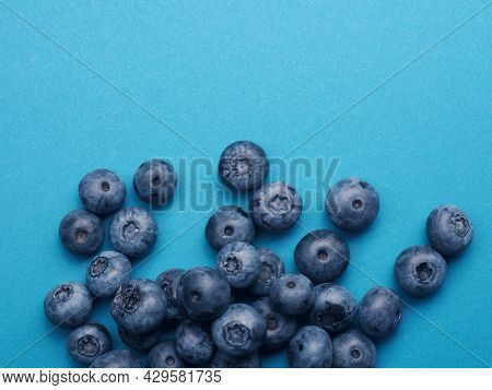 A Bunch Of Blueberries On A Blue Background, Super Food, Healthy Eating Concept, Anitoxidants, Sprac