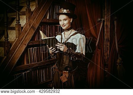 Beautiful steampunk lady scientist stands in her library and reads a book. Victorian vintage interior.