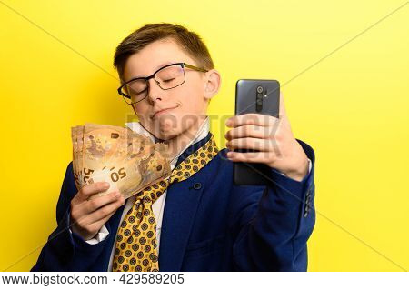 Boy In A Big Suit, Selfie On A Yellow Background With Money.
