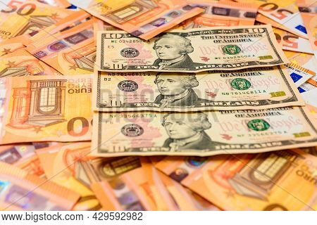 Texture Of Money From Dollars And Euros, Ten Dollars And Fifty Euros.