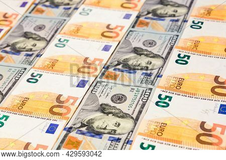 Dollars And Euros, Confrontation And Domination, Influence, World Currencies Close Up.