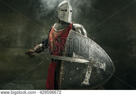 One Medeival Warrior Or Knight In Armor And Helmet With Shield And Sword