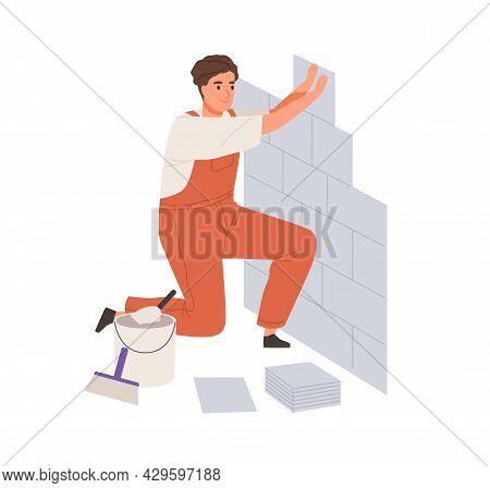 Repair Worker Laying Ceramic Wall Tile. Professional Tiler In Uniform Working. Repairman In Overalls
