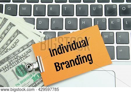 Banknotes, Iron Clamps, Colored Paper With The Word Individual Branding