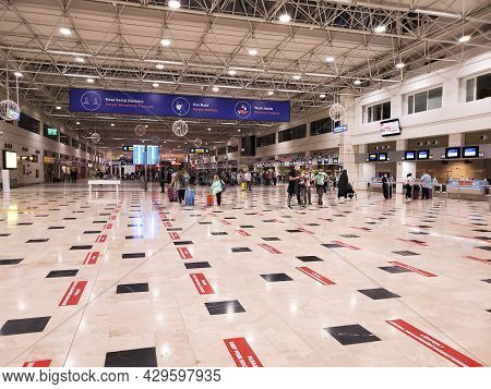 Hall Of International Airport Of Antalya Turkey With Keeping Social Distancing Precaution On Tiled F