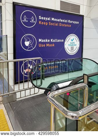 Blue Banner Certificate Of Safe Tourism In Antalya Airport Turkey. Symbols And Precautions Above Esc