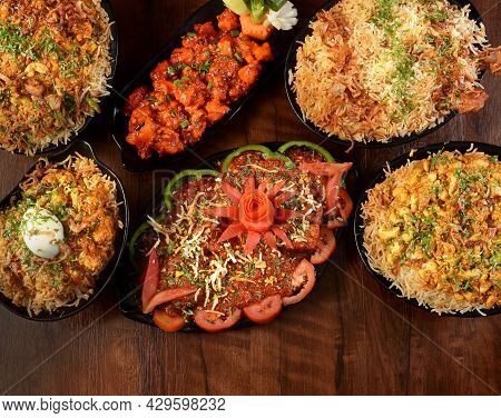 Assorted Indian Foods Mughal Chicken Biryani,chicken Manchurian,kaju Biryani,chicken Dum Biryani And