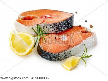 Slice Of Raw Fish Salmon With Lemon, Rosemary And Isolated. Salmon Steaks On White Background. Salmo