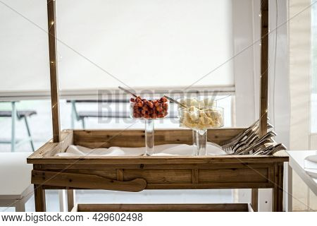 Wooden Stand With Fresh Fruits Ready To Be Served