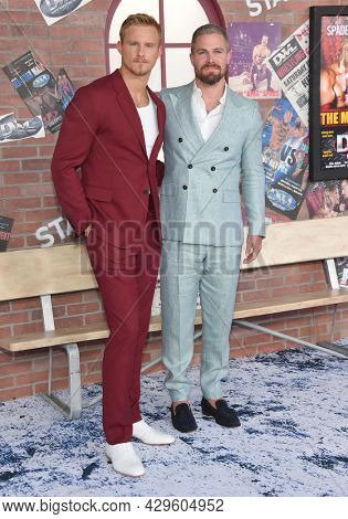 LOS ANGELES - AUG 08: Alexander Ludwig and Stephen Amell arrives for the STARZ 'Heels' Los Angeles Premiere on August 08, 2021 in Los Angeles, CA