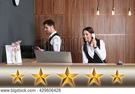 Five Star Luxury Hotel. Receptionists Working At Desk In Lobby