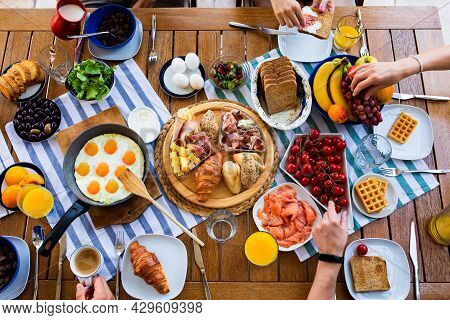 Laid Table With Food.breakfasts On The Table Top View.large Table With Food Top View. Food And Peopl