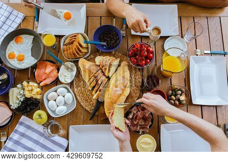 Beautiful Breakfasts On The Table Top View. Large Table With Food Top View. Table With Food And Peop
