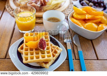 Breakfast With Coffee.waffles For Breakfast With Jam And Fruit.homemade Waffles With Berries In A Pl