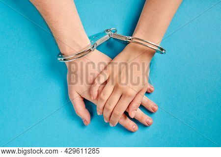 Love Forever. Male And Female Hands In Handcuffs. Prenuptial Agreement, Duties Of Love Couple.