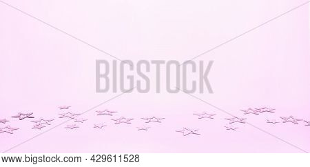 Scattered Metallic Star Shape Confetti On Pink Background