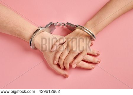 Male And Female Hands In Handcuffs. Love Forever. Prenuptial Agreement, Duties Of Love Couple.