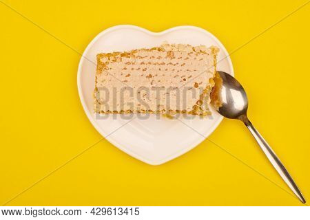 Honeycomb On Plate, Sweet-tooth Concept. Delicious Lime Honey, Yellow Background. Love For Sweets.