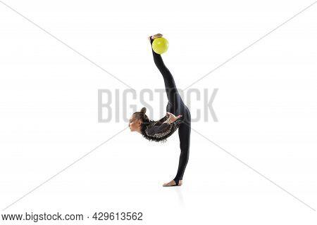 Young Female Athlete, Rhythmic Gymnastics Artist Isolated On White Studio Background. Beautiful Girl