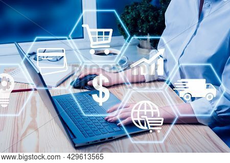 Hand Using Laptop With Global Reports And Stock Market Change Concept. E-commerce Concept. E-commerc