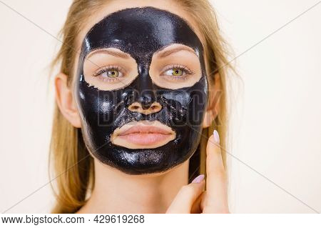 Young Woman With Carbo Detox Black Peel-off Mask On Her Face, On White. Teen Girl Taking Care Of Oil