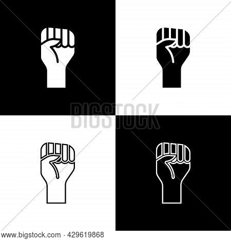 Set Raised Hand With Clenched Fist Icon Isolated On Black And White Background. Protester Raised Fis