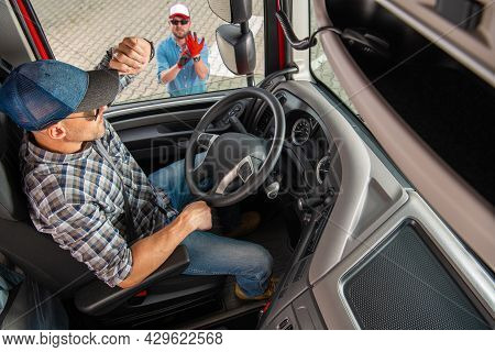 Modern Semi Truck Vehicle Driver Talking To His Truck Dispatcher Making Sure Deliver Will Be Made In