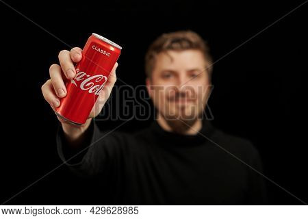 Kaliningrad, Russia - March 13, 2021 - Young Guy With Coca Cola Can In Hand, Black Background. Class