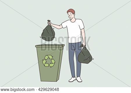 Saving Ecology And Recycling Concept. Young Smiling Man Cartoon Character Standing Holding Trash Bag