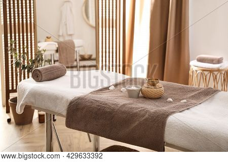 Stylish Room Interior With Massage Table In Spa Salon