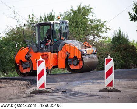 Shallow Dof Road Works Restraints. Unfocused Reflective Paint Sign. Heavy Vibration Roller Compactor