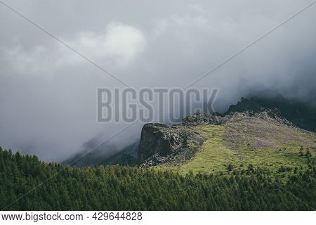 Atmospheric Mountain Landscape With Great Rocks In Gray Cloudy Sky. Awesome Overcast Scenery With Lo