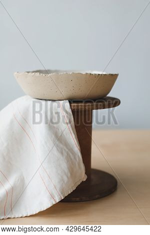 Ceramic Bowl On A Wooden Table Top View. Handmade Ceramic Tableware And Pottery