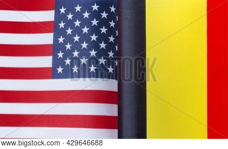 Fragments Of The National Flags Of The United States And Belgium Close-up