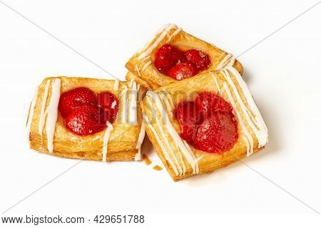 Puff Pastry Pies With Strawberries On A White Background. Puff Pastry Filled. Photo.