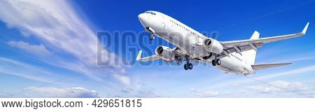 Modern Airliner Against A Cloudy Blue Sky
