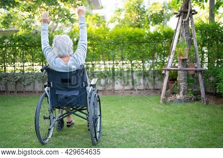 Asian Senior Or Elderly Old Lady Woman Patient Exercise On Wheelchair With Happy Fresh Enjoy In Home