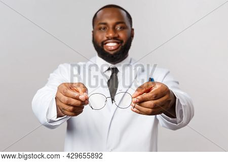 Healthcare, Medicine And Hospital Treatment Concept. Here You Are Try This Glasses. Portrait Of Hand