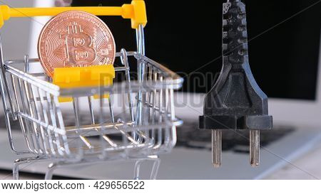 Cryptocurrency Bitcoin Power Supply Socket. Hand Holding Plug Have Computer Monitor In The Back, Con