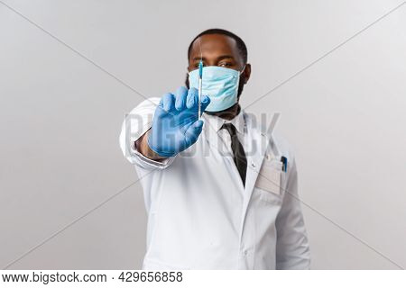 Covid19, Pandemic And Healthcare Concept. Serious African-american Hospital Doctor, Medical Face-mas