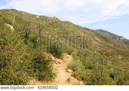 Hiking Trail On An Arid Mountainous Slope Covered With A Chaparral Woodland Taken At The High Desert