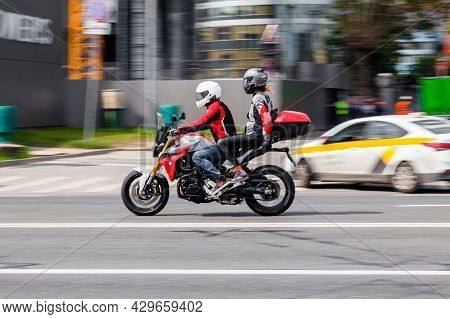 Man And Woman Riding On Bmw F 900 R Motorcycle. Young Couple Riding Motorbike On City Road. Moscow,